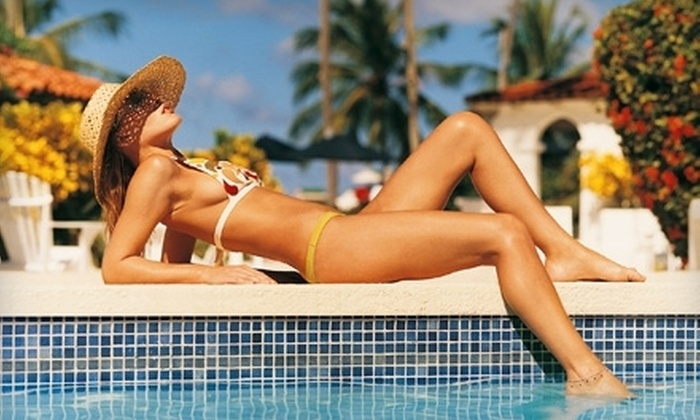 Solar Planet  - Cow Hollow: $40 for Four UV or Spray-Tanning Sessions at Solar Planet (Up to $108 Value)