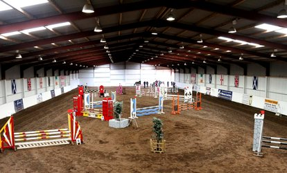 image for One-Hour Horse Riding Lesson for One or Two at Mackenzie's Equestrian Centre (Up to 55% Off)