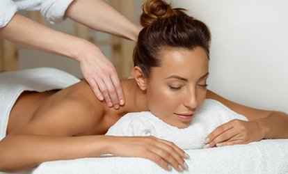 Massage, Facial, or Brazilian Hair Removal at Hand & Stone Massage and Facial Spa (Up to 55% Off)