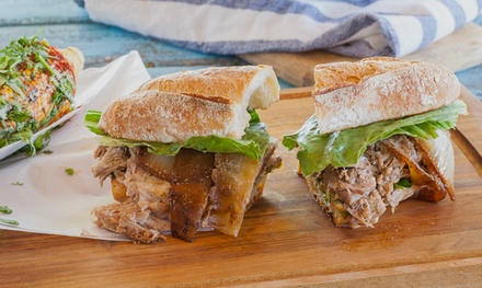 Caribbean Sandwiches and Food at Paseo Caribbean Food (Up to 44% Off). Two Options Available.