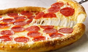 Pizza Inn: Pizza Meal for Two or Four with Breadsticks and Iced Tea at Pizza Inn (Up to 53% Off)
