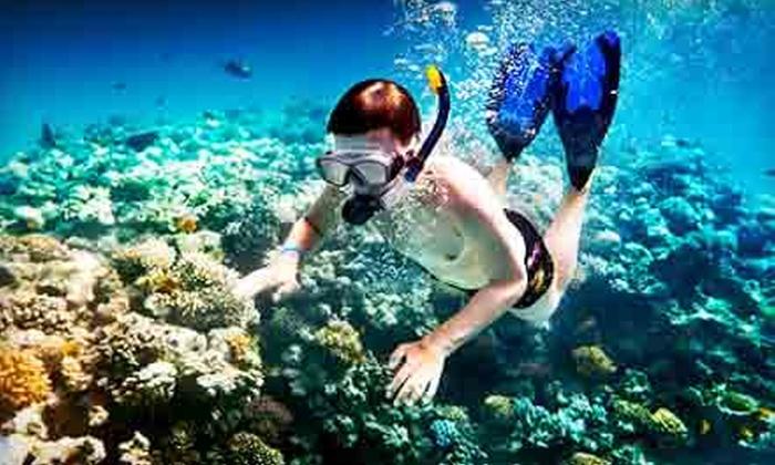 Island Magic Catamaran - Ala Moana - Kakaako: Snorkeling Cruise for One Child or Adult or an Adult Sunset Cruise from Island Magic Catamaran (Up to 52% Off)