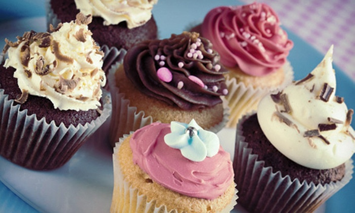 Sweet Loralee Pastries - Wake Forest: One or Two Dozen Kiss Cupcakes at Sweet Loralee Pastries (Up to 55% Off)