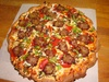 50% Off Medium Pizzas with One Topping at Casamel's Pizza