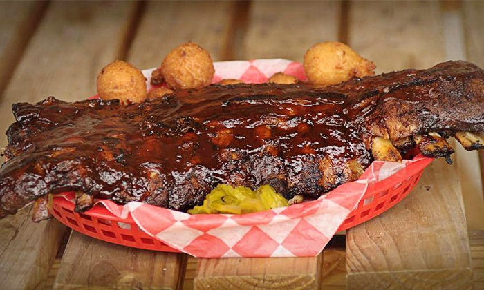 Q2U BBQ Pit - Clover: Barbecue for Two or Four, or Take-Out Package at Q2U BBQ Pit (Up to 42% Off)