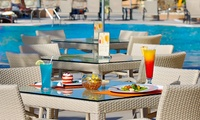 Friday Brunch with Beverages and Pool Access for Up to Four at Sevilla Restaurant at Al Raha Beach Hotel (Up to 54% Off)