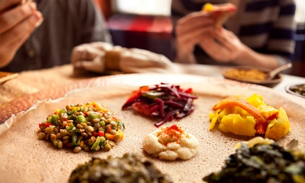 Ethiopian Cuisine and Drinks at Rosalind's Ethiopian Cuisine (Up tomissing id 9f64a212-6715-11e2-ac8e-00259060ae36 Off). Three Options Available.