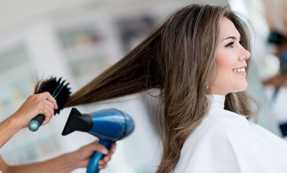 $39 for a Haircut or Style with a Blowout with Arpad Scott at Luxe Salon and Day Spa ($65 Value)