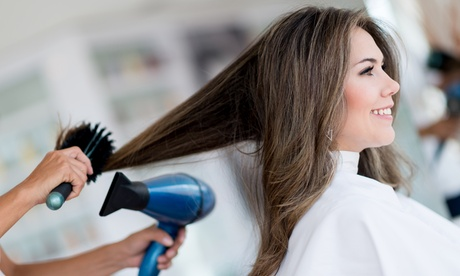 Blow-Dry, Flat Iron, and Trim, or Blowout, Shampoo, and Conditioner at Natural Root Salon (Up to 47% Off)