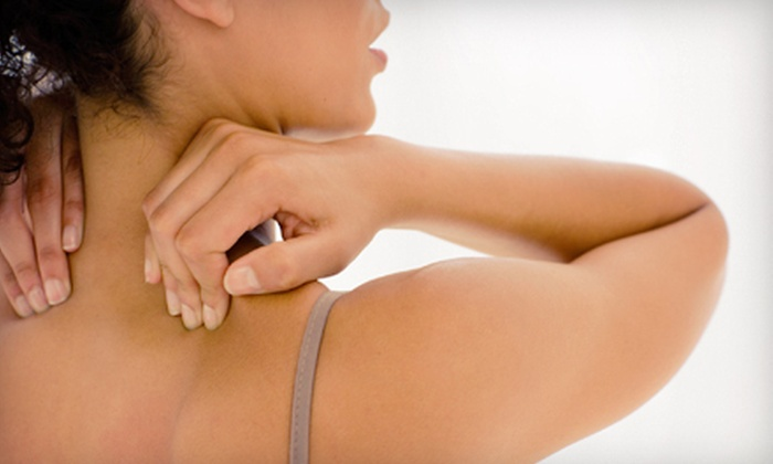 Essential Health Center - Jefferson: Chiropractic Exam with X-rays, Massage, and Option of Two or Four Treatments at Essential Health Center (Up to 91% Off)