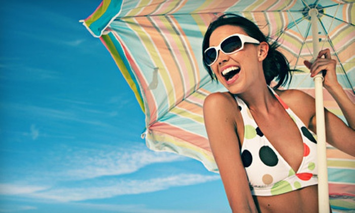 Bronze Bay Tanning - Colorado Springs: One Month of Unlimited UV Tanning or One or Four Laser Airbrush Spray Tans at Bronze Bay Tanning (Up to 55% Off)
