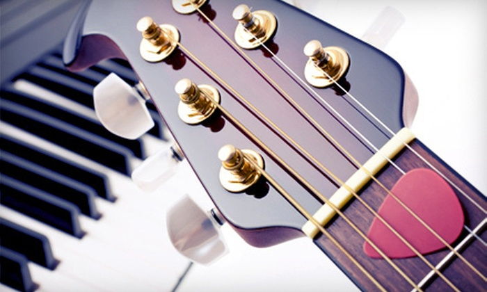 Guitar Cities Chicago - Fidi: Two, Four, or Six 30-Minute Private Guitar, Piano, Bass, or Ukulele Lessons at Guitar Cities Chicago (Up to 59% Off)