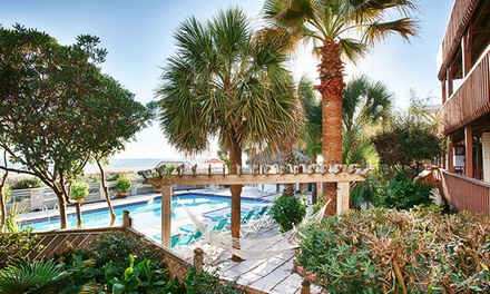 groupon daily deal - 1-Night Stay for Two Adults and Two Kids Aged 15 or Younger at The Winds Resort Beach Club in Ocean Isles Beach, NC