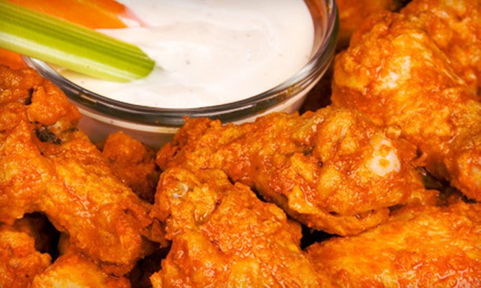 Wally's Wicked WIngs - Richland: Two Appetizers and 16 Mammoth or 20 Boneless Wings or $15 for $30 Worth of Pub Food at Wally's Wicked Wings