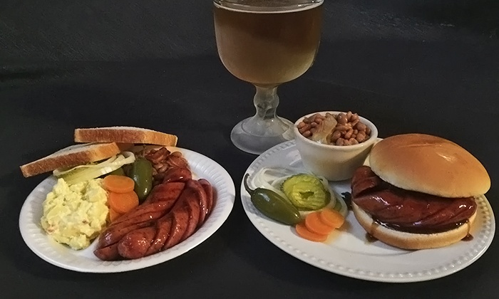 Augie's Barbed Wire Smokehouse and Augie's Alamo City BBQ Steakhouse - Multiple Locations: Sausage Plates or Sandwiches for Two with Sides and Trimmings (Up to 50% Off)