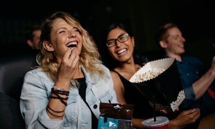 One, Two, or Four Tickets with Popcorn and Drinks at Smitty's Cinema (Up to 50% Off)
