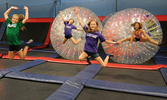 Helium Trampoline & Climbing Park - New Berlin: Open Jump for 2 or 4, or Party for 20 at Helium Trampoline & Climbing Park (Up to 50% Off). Five Options.