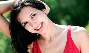 Warner Village Cosmetic & Family Dentistry: Two Veneers or One Crown with a Dental Exam at Warner Village Cosmetic & Family Dentistry (Up to 47% Off)