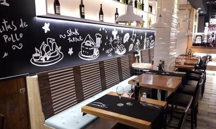 Menú de paella con principal, 4 tapas, postre y con opción a botella de vino desde 24,95 € en Saraya Cuina Mediterranea