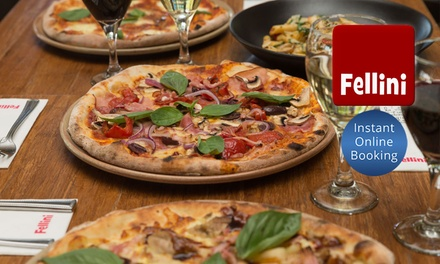 Three-Course Italian Meal with Wine for Two ($39) or Four People ($75) at Cafe Fellini (Up to $189 Value)
