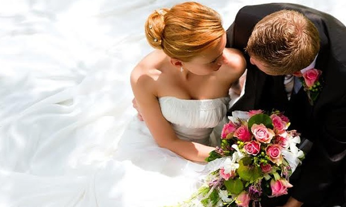E & J Dry Cleaners - E & J Cleaners: $179 for a Wedding-Gown Cleaning and Preservation in an Acid-Free Chest Box at E&J Dry Cleaners ($358 Value)