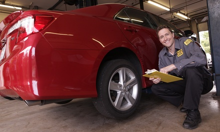 Conventional or Synthetic Oil Change w/ Wiper Blades at Precision Tune Auto Care (Up to 64% Off). Four Options.