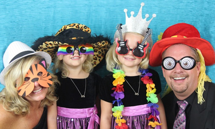 Capture The Moment Photography - Des Moines: Two- or Three-Hour Photo-Booth Rental with Unlimited Prints from Capture The Moment Photography (55% Off)