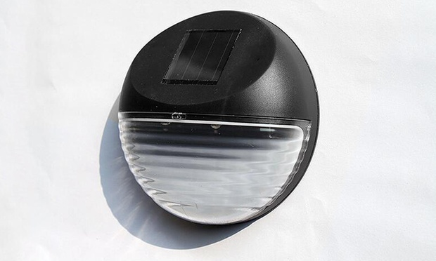 Round Solar Powered LED Fence Light: One ($9), Two ($16) or Four ($24)