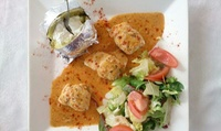 Menú para 2 o 4 con surtido de entrantes, mariscada, postre y bebida desde 49,90 € en Es Mollet