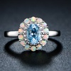 Genuine Blue Topaz and White Fire Opal with Diamond Accent Flower Ring
