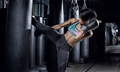 image for Four or Eight Kickboxing Classes with Gloves at King's ATA Celebrity Martial Arts (Up to 80% Off)