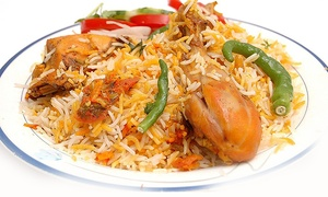 Dhaniya Drums Indian Food: $18 for $30 Worth of Indian Food and Drinks for Dinner for Two at Dhaniya Drums Indian Food