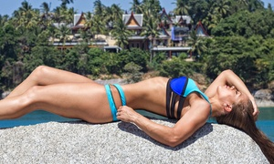 Tan Republic: Two Spray Tans or One or Three Months of Silver-Level UV or Red-Light Tanning at Tan Republic (Up to 73% Off)