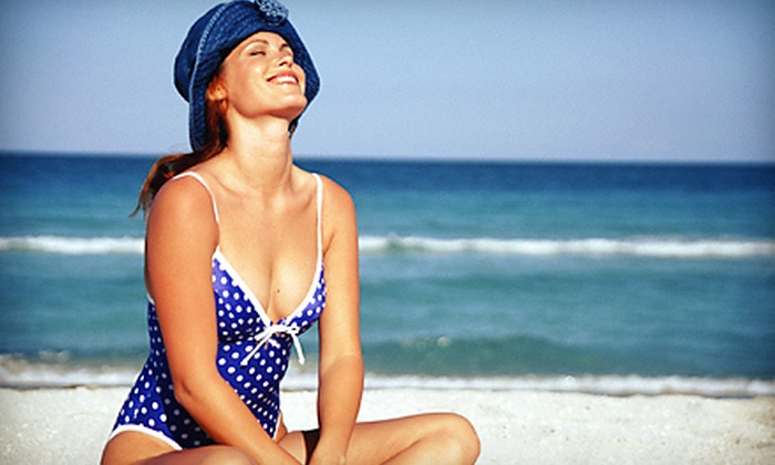 Planet Beach Contempo Spa - Multiple Locations: Four Mystic Spray Tans or a Renewing Spa Package at Planet Beach Contempo Spa (Up to 85% Off)