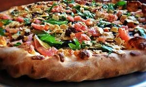 Famous Yeti's Pizza: Thin Crust or Stuffed Pizza at Famous Yeti's Pizza (Up to 43% Off). Three Options Available.
