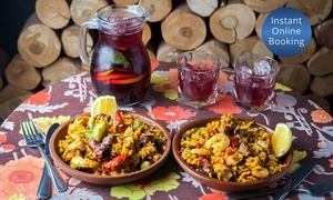Toro Bravo: Paella with Sangria for Two ($45), Four ($88) or Eight People ($169) at Toro Bravo (Up to $296 Value)