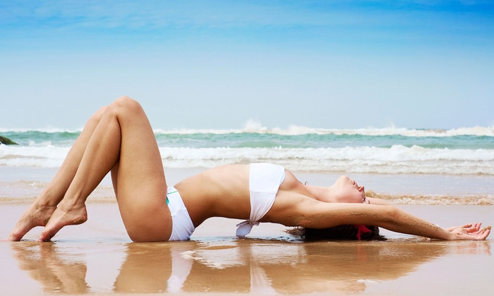 Electric Beach - Eastchester: One or Three Custom Organic Spray Tans or One or Three Months of Unlimited Tanning at Electric Beach (Up to 76% Off)