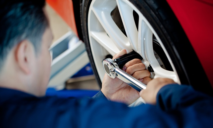 Meineke Car Care Center - Pflugerville - Pflugerville: $59 for Synthetic Oil, Tire Rotation and 4-Wheel Balancing ($130 value)