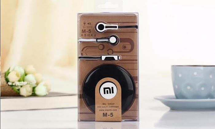 SDI אס די איי יבוא ושיווק - Merchandising (IL): אוזניות דיבורית MI M5 מבית XIAOMI העולמית, לכל סוגי הסלולר, טאבלטים ונגנים