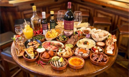 6 or 12 Spanish Tapas with a Bottle of Wine for Two or Four at El Puerto