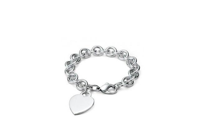 Petalouda: Sterling-Silver Heart Charm Bracelet or Flower Crystal Earrings in Two Colors at Petalouda (Up to 79% Off)
