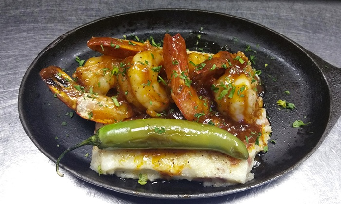 Ace's Ice House & Chop Shop - Frisco: $12 for $20 Worth of Texas Casual Pub Fare and Drinks for Two at Ace's Ice House & Chop Shop