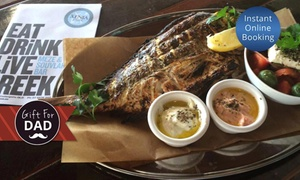 Xenia Grill: Greek Lunch or Dinner with Bottle of Wine for Two ($69), Four ($129) or Six ($189) at Xenia Grill (Up to $420 Value)