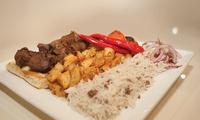 Lebanese Banquet with Glass of Wine for Two ($45) or Four People ($89) at Beiyrut Restaurant (Up to $220 Value)