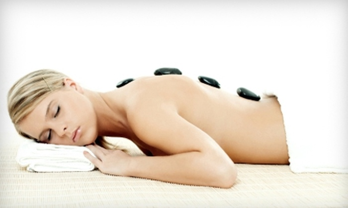 The Woodhouse Day Spa - Franklin: Volcanic Stone Massage or SkinCeuticals Brightening Facial with Eye Contour Treatment at The Woodhouse Day Spa in Franklin