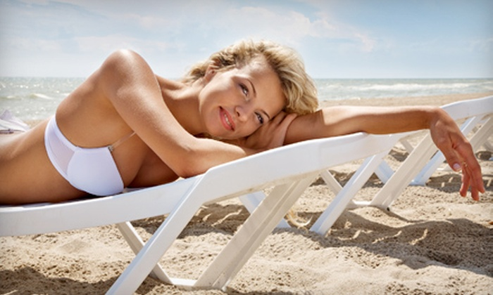 Glow Tanning Center - Delray Beach: One or Three Personalized Airbrush Tans or One Month of High-Pressure UV Tanning at Glow Tanning Center in Delray Beach (Up to 62% Off)
