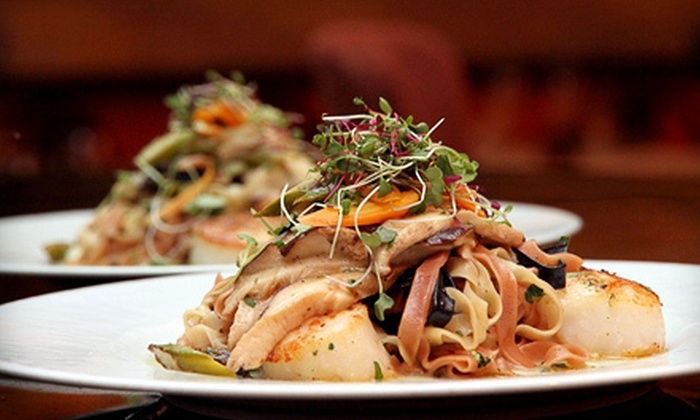Nino's Tuscany - San Juan Hill,Midtown West,Theatre District: $79 for a Four-Course Dinner for Two with a Bottle of Wine at Nino's Tuscany (Up to $200 Value)