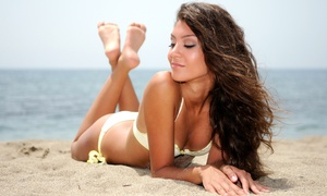 GoldenSun Tan: 30-Day Unlimited UV Tanning Package or Three VersaSpa Spray Tans at GoldenSun Tan (Up to 54% Off)
