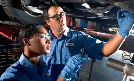 Brake-Pad-Replacement Package with Oil Change at Meineke Car Care Center (Up to 50% Off). Two Options Available.