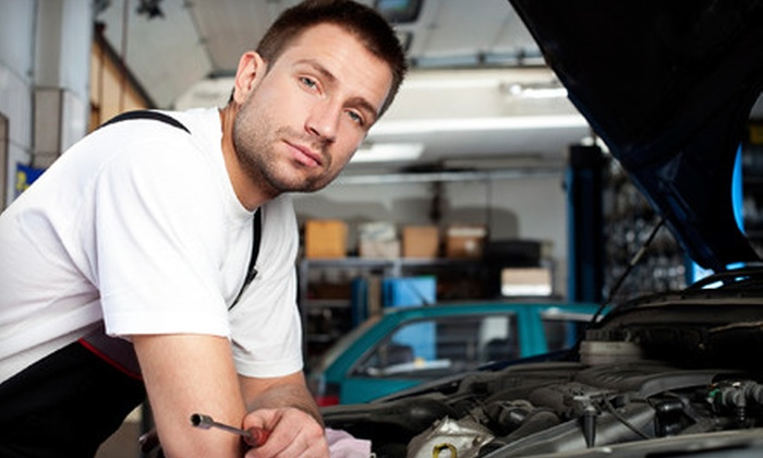 International Auto Body & Frame - Foothill Farms: One or Two Oil-Change Packages or Headlight Restoration at International Auto Body & Frame (Up to 58% Off)